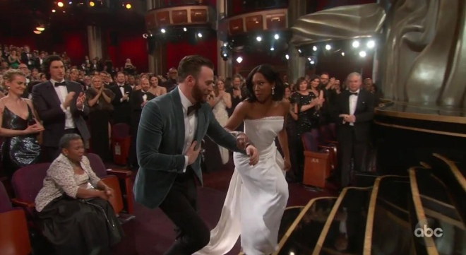 Chris Evan's kind gesture as he offered his hand to Regina King as she made her way to collect her award for Best Actress in Supporting Role